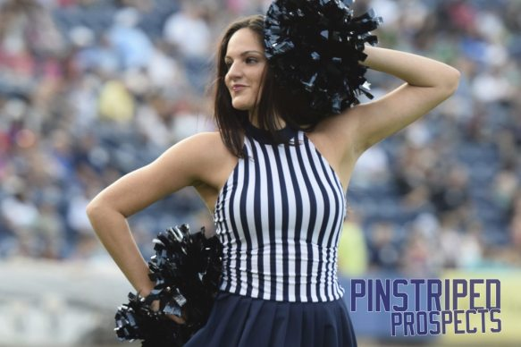 A member of the Pinstripe Patrol dance team performs in between innings (Robert M. Pimpsner)
