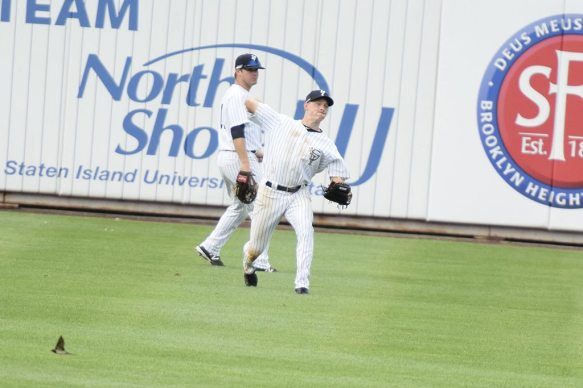 CF Jeff Hendrix fires the ball into the infield on a play (Robert M Pimpsner)