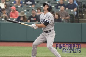 Ty McFarland singles on a pop up to third base (Robert M. Pimpsner)