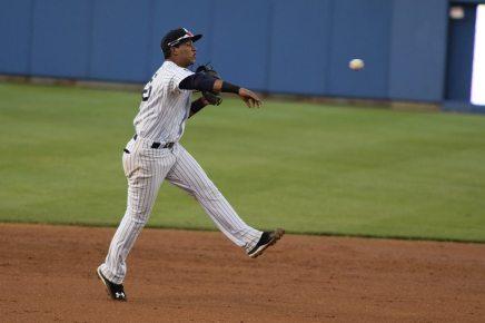Thairo Estrada making a defensive play (Robert M. Pimpsner)