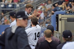 Griffin Gordon is congratulated by Kyle Holder after plating the first run of the game (Robert M Pimpsner)