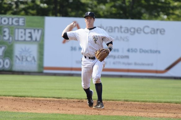 Kyle Holder fields the ball to make the first out of the fourth inning (Robert M Pimpsner)