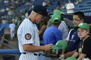 Fans get autographs from the Staten Island Yankees before a game. (Robert M Pimpsner)