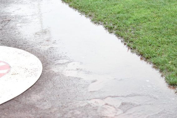 Puddles lined the warning track prior to the game after it rained (Robert M Pimpsner)