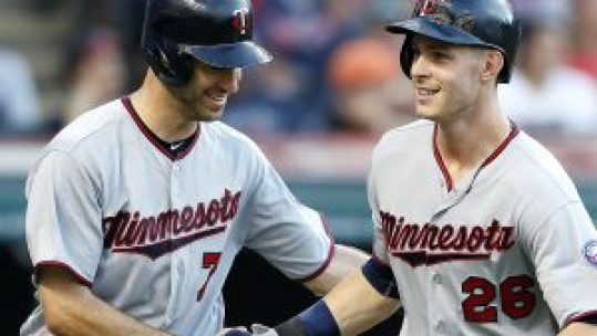 Minnesota Twins' Max Kepler (26) and Joe Mauer against the Cleveland Indians during the third inning of a baseball game Monday, Aug. 1, 2016, in Cleveland. (AP Photo/Ron Schwane)