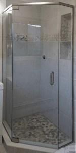 Semi frameless neo-angle shower incorporating pivot hinges on the door