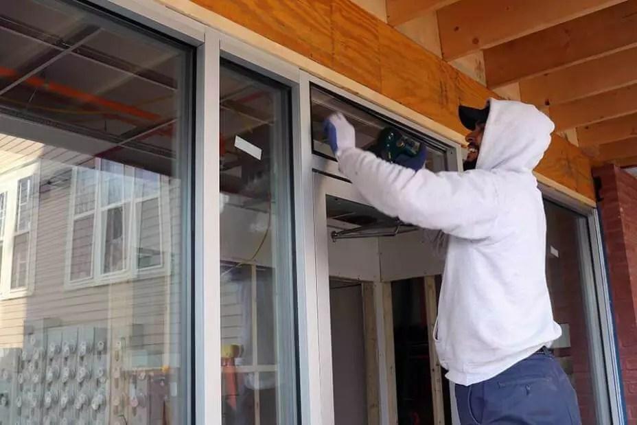 Pioneer Employee Installs Top Part of Storefront Exterior Door
