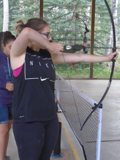 Alberta Camp Cherith Girl Posing to Shoot Arrow