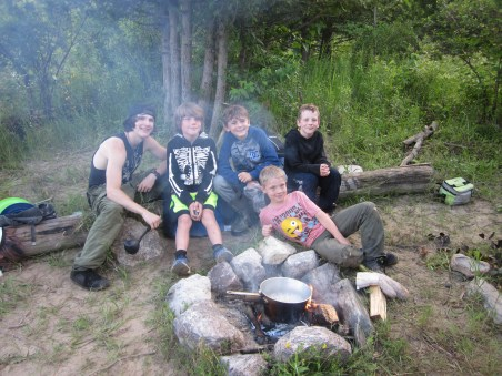 Ontario Camp Cherith boys w camp fire cooking in daylight