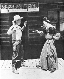Cactus Kate giving Gene Autry a typical Western greeting