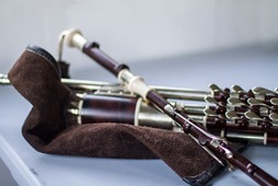 A new set of uilleann pipes in the key of D. made from African blackwood, brass and imitation ivory with a hollow main stock