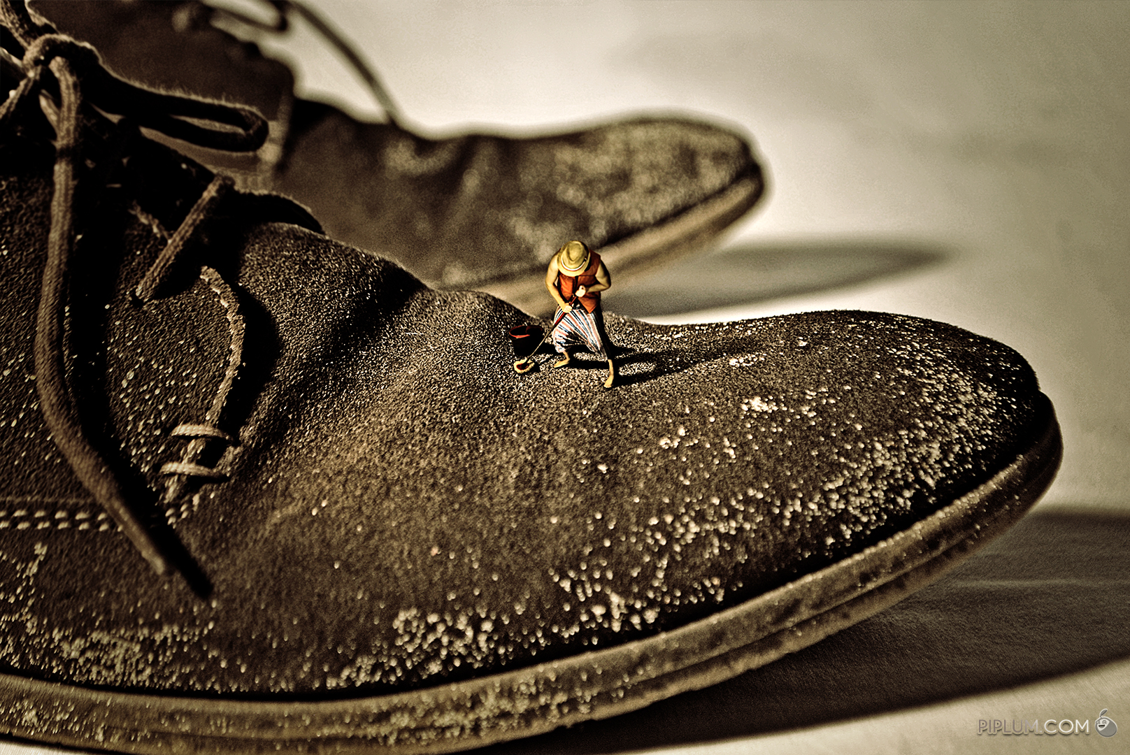 If-you-don't-build-your-dream-someone-will-hire-you-to-help-build-theirs. Mn cleaning his boss shoes. Surreal photography.