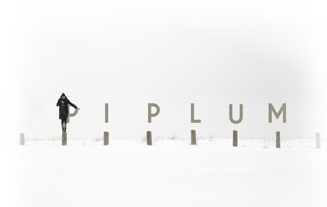 piplum-winter cover. Girl standing in snow during cold winter