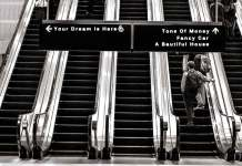 Motivational quote. Stairs in the airport showing different paths of life.