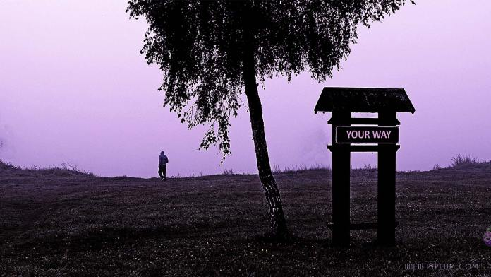 Your way. Man walking in the mist by the lake. Motivational quote.
