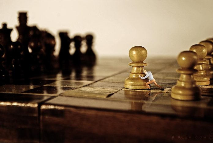 man-playing-chess-surreal-photography