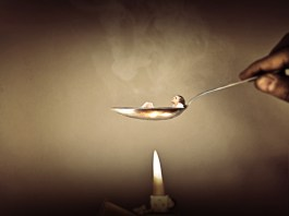 Women lying in a spoon as in a bath. Below is a lighter fire is going to boil her, if she won't take any action to move out of comfort zone. How long your comfort zone will last? Motivational surreal quote.