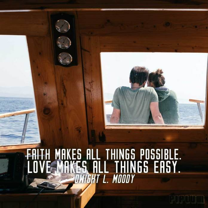Love quote. couple sitting in the front of the yacht and enjoying the view.