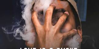 Love quote. Mans face covered with his hand and by dense smoke.