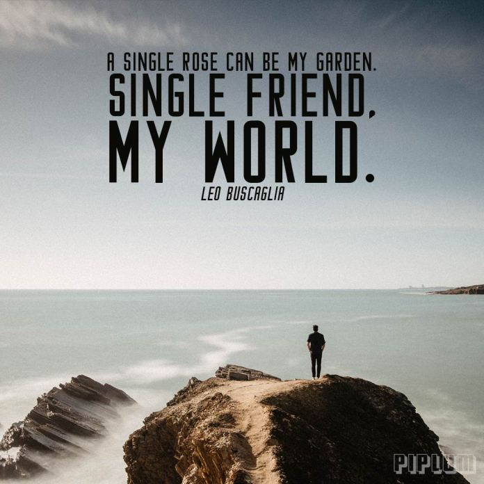 Friendship quote. Man standing alone on the rock and facing the wast ocean.