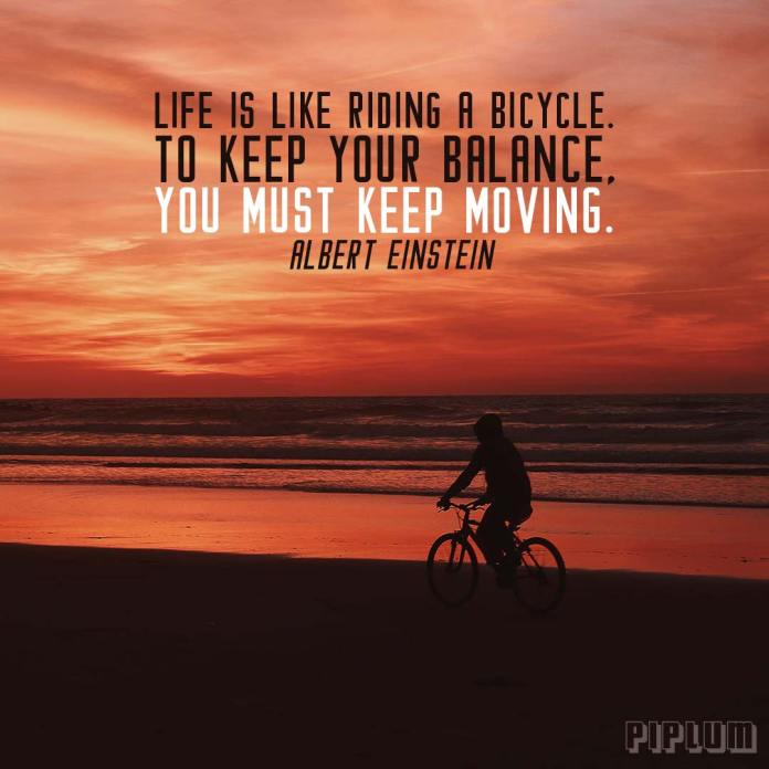 Life Quote. Human riding a bike in a beach during sunset.