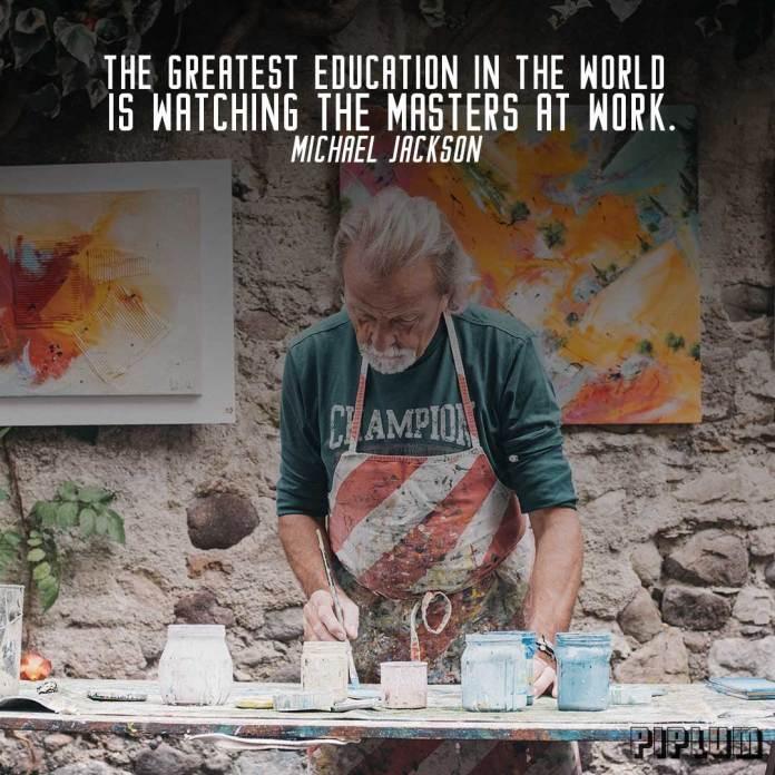 Work quote. Artist painting in his studio.