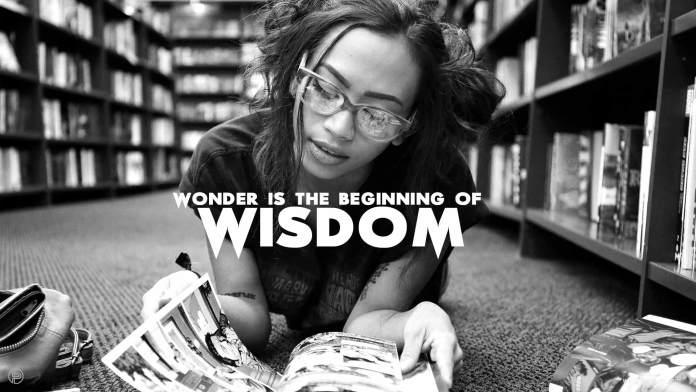 inspirational-quote-girl-reading-books-in-the-library