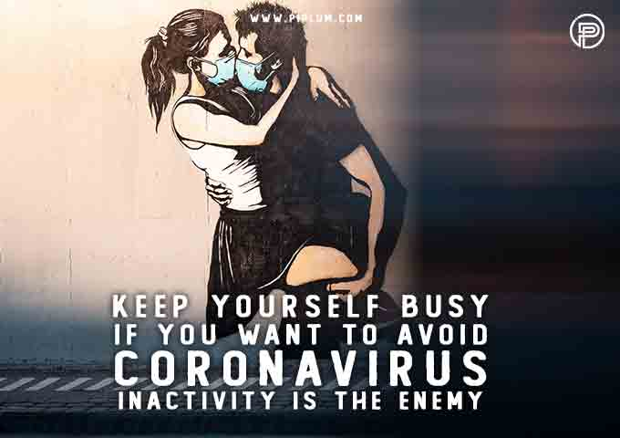 couple-kissing-with-the-masks-on-wall-painting-words-Inactivity-is-the-enemy