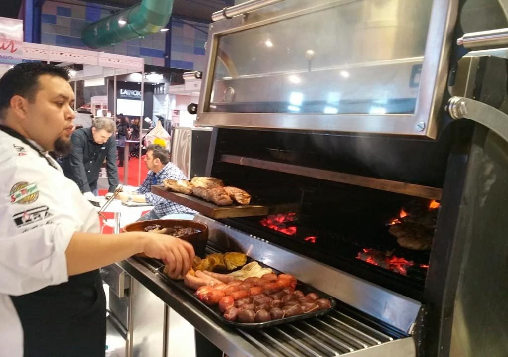A chef cooking meat with a Pira 120 ED.