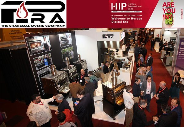A Pira stand with charcoal ovens and people enjoying the food. PIRA and HIP logos at the top