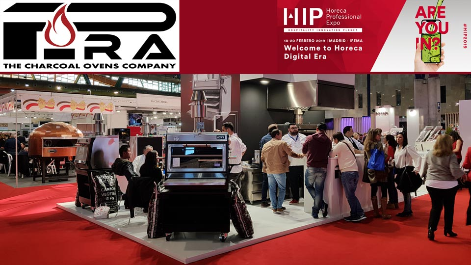 Logos of PIRA and HIP 2019 and a Pira stand with people and some of our ovens a 90ED at front