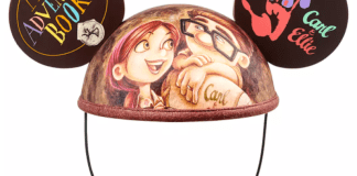 """Mouse Ear hat with young Carl and Ellie in the center, One ear says """"My Adventure Book"""" and one ear has """"Carl & Ellie"""" with handprings"""