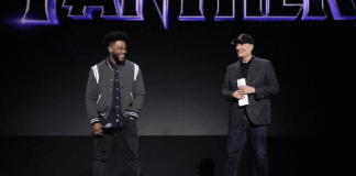Ryan Coogler and Kevin Feige on state with the words Black Panther on a screen behind them