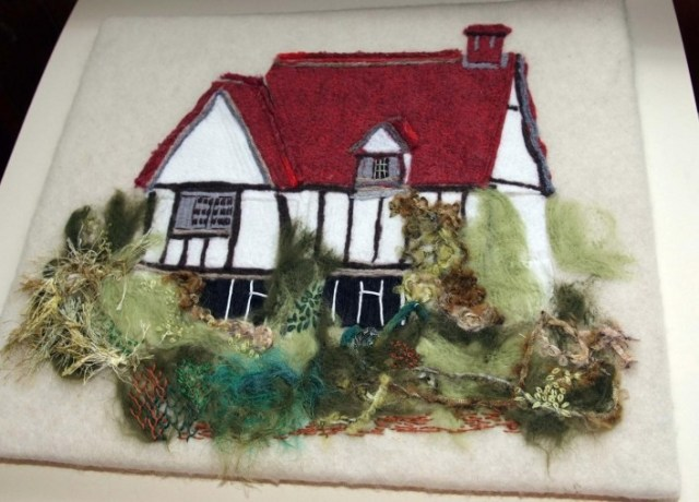 Sue Keen made this felt picture of the cottage .