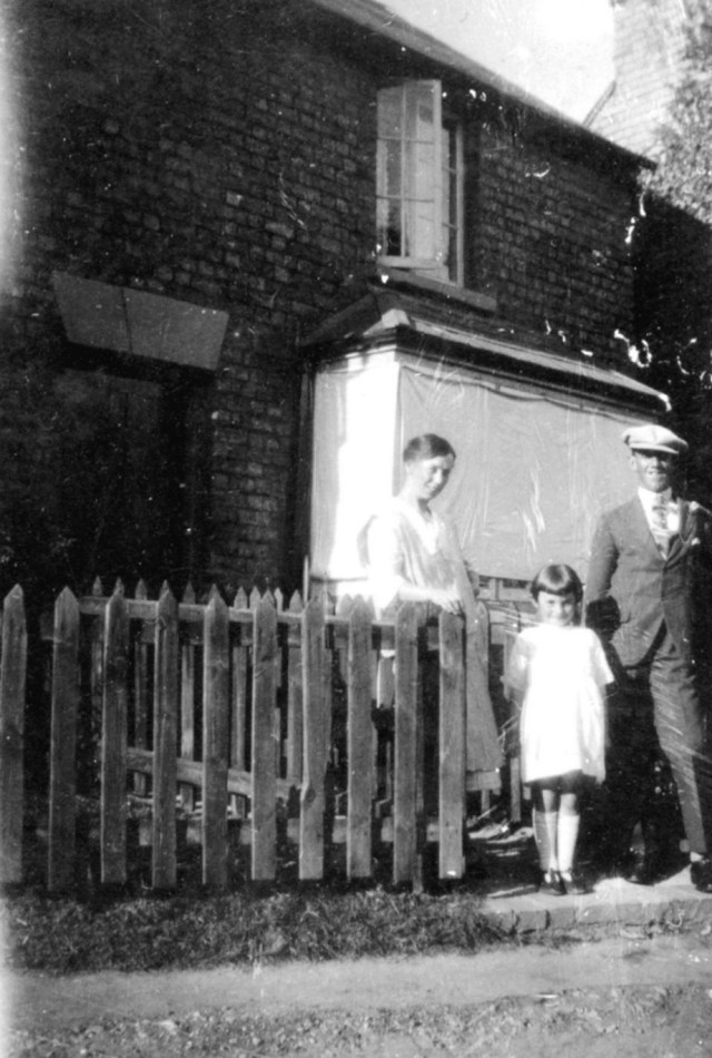 Ruth and Ted Titmuss with the their daughter Vera outside the hardware shop in the late 1920s