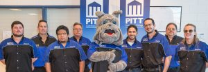 pcc automotive students with a mascot