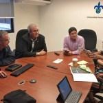 4 people meeting over student exchange program