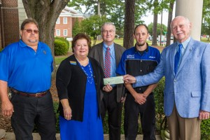 On behalf of the Kiwanis of the Golden K Foundation, Bob Hursey (right) and Ray Jernigan (center) present the Ricks Automotive Scholarship to PCC Automotive Systems Technology (AST) student Joshua Sweezy (second from right). On hand for the presentation were PCC AST Department Chair Norman Lilley and PCC Vice President of Institutional Advancement Susan Nobles, who also serves as executive director of the PCC Foundation.