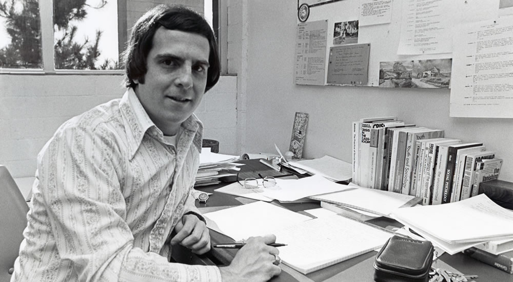 Peter Nardi, professor of sociology, at his desk in the 1970s.