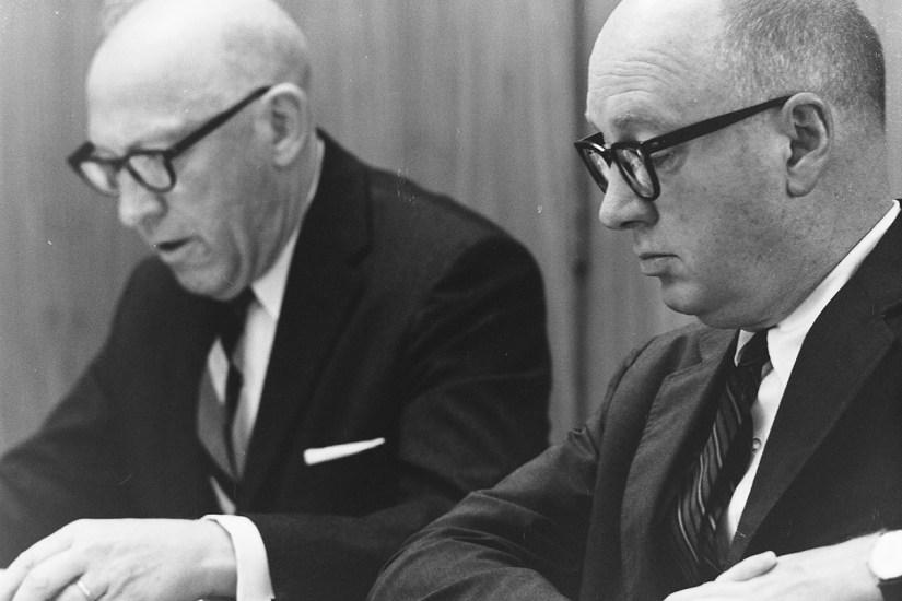 Robert Bernard and John Atherton at Faculty Meeting, 1964