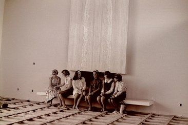 Students Sitting in Front of the Fireplace in the Unfinished Sanborn Living Room, August 15, 1964