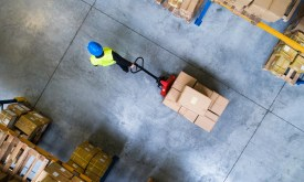 An aerial view of an employee pulling items through a warehouse. Whether or not you've ever used them before, you might need 3pl warehousing to do business during COVID. Here are some tips to choose wisely.