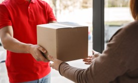 Delivery,Of,Parcel,From,Courier,To,Client,At,Home.,Deliveryman