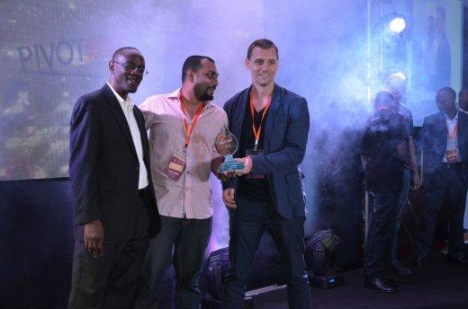 Ivan Lumula Of Microsoft awarding Mikul Shah and Johann Jenson of Sleepout