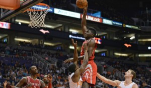 Oct 13, 2015; Phoenix, AZ, USA; Houston Rockets center Clint Capela (15) drives the ball against Phoenix Suns point guard Brandon Knight (3) in the second half at Talking Stick Resort Arena. Mandatory Credit: Jennifer Stewart-USA TODAY Sports