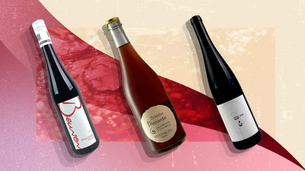 Three bottles of wine on a red background