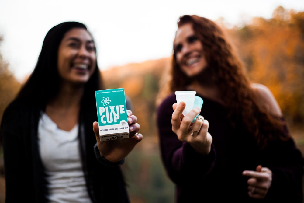 two girls holding pixie cups