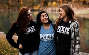 girls wearing pixie t-shirts smiling