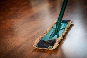 a person mopping the wooden floor
