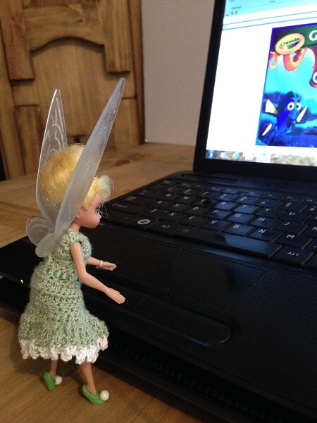 Tinkerbell typing at computer.